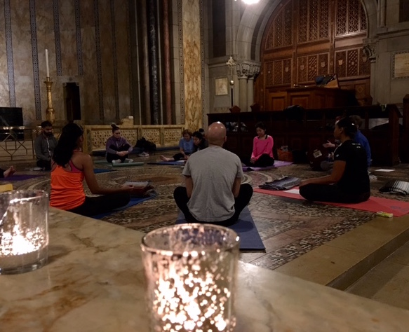 Yoga surrounded by candles